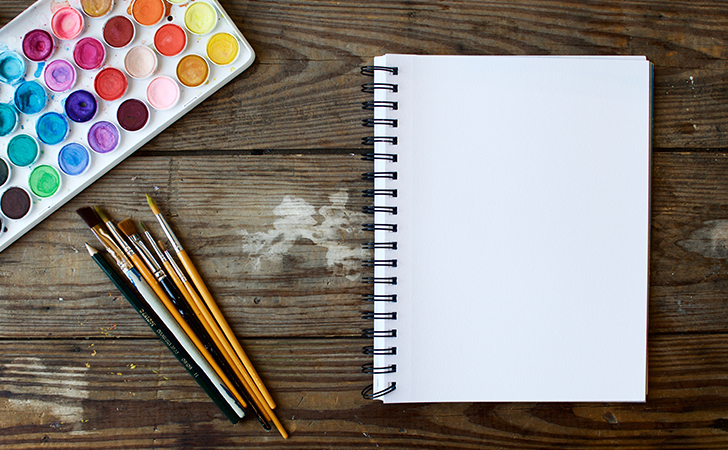How to stay creative when you keep getting interrupted. Tips on creativity. Audio Podcast on creativity. image of a blank notepad and brushes and water paints.