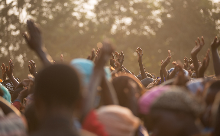 How Your Church Website Can Be An Evangelism Tool. Share The Gospel With Your Church Website. Evangelism tools. Church websites. Picture of people in Africa holding up their hands.