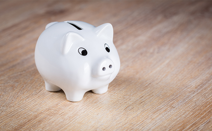 Stewardship - Become a better steward of God's resources . Tithing. Tithe. Giving. Offering. Image of a white piggy bank on a wooden floor.