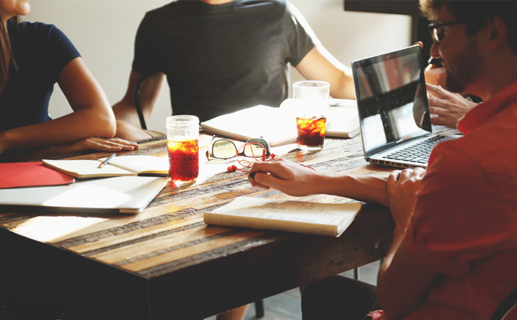 Encouraging innovation with your church staff. church website. church websites. how to use Facebook. image of a staff sitting around the table.